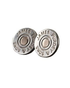 The Purdey London round sterling silver and gold cartridge cap cufflinks.