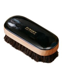 The Purdey London dark ox horn small shoe brush.