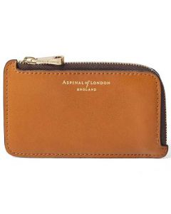 This tan coin purse has been designed by aspinal of london.