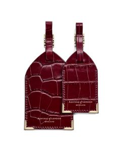 Aspinal of London bordeaux mock croc leather luggage tags.