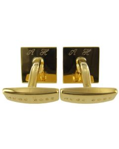 This pair of Hugo Boss gold cufflinks have been engraved with initials.