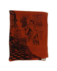 This Paul Smith orange scarf comes  with a villa pattern on it.