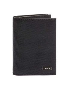 This TUMI black leather card holder comes with the brand name on the front.
