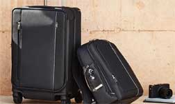 TUMI LEATHER & TRAVEL